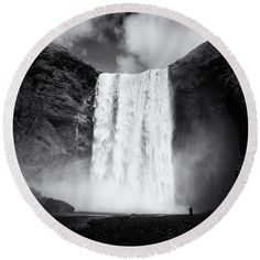 "Round beach towel: Waterfall Skogafoss in Iceland black and white. This roundie is perfect for a day at the beach, a picnic, an outdoor music festival or just general home decor. This versatile summer essential is a must-have this season! The beach towel is 60"" in diameter and made from ultra-soft plush microfiber with a 100% cotton back.  Matthias Hauser hauserfoto.com"