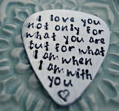 Hand Stamped Sterling Silver Guitar Pick. if he plays guitar.....or he could give it to me :)