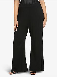 """Classic and chic, these black palazzo pants are high-waisted with a flat front and side zipper entry. Made from sexy stretch challis, the wide-legged pants look great with our crop tops.<ul><li> 30"""" inseam</li><li>Rayon/spandex </li><li>Wash cold, line dry </li><li>Imported plus size pants</li></ul>"""