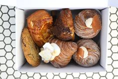 """Whether you're carb-loading before the race or in search of that post-race treat, you need to stop at Mr. Holmes Bakehouse. They've got all of the usual bakery delights like doughnuts and cookies as well as unusual treats such as matcha croissants and pineapple caramel sticky buns. Their signature """"cruffins"""" - croissants baked in a muffin tin, rolled in sugar, and filled with pastry cream are a must in every runner's life."""