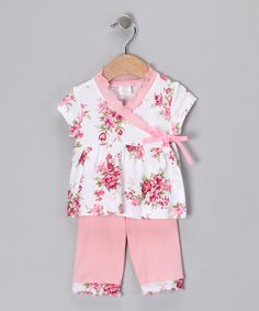 As charming as a rose garden but without those troublesome thorns. This soft cotton ensemble, featuring a mesmerizing floral print, is a cozy way to outfit a little one for a day of adventure or a round of snuggles.Includes top and pants100% cottonMachine wash; tumble dryMade in the U...