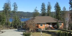 Tranquil setting with nice Hauser Lake views on a professionally landscaped parked-out acre.  You're LESS than 5 minutes to the public boat launch and big sandy beach & picnic area!  Distinguished rancher is move-in ready with no deferred maintenance.  The main level is anchored by a pretty stone fireplace in the family room and big windows framing those pretty lake views.  There are 3 bedrooms on this level, including a master suite with vaulted ceilings and a water view.  ...