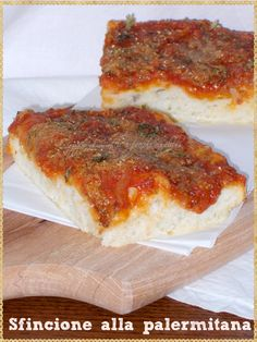 Sfincione alla palermitana (Sfincione of Palermo is a thick Sicilian pizza or focaccia, topped with tomato, onions, anchovies and grated caciocavallo cheese and oregano)