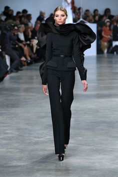 Stephane Rolland...lo've her take on a pantsuit. Would wear it in every color.