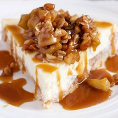 Celebrate fall w/ this salted caramel apple cheesecake! Butter crust, cinnamon apples, creamy cheesecake, and pecan oat crisp.