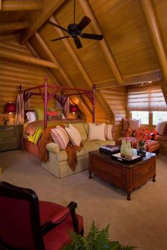 2nd floor cozy bedroom with cathedral ceilings, round beams and a dormer to view the majestic Western North Carolina mountains from.