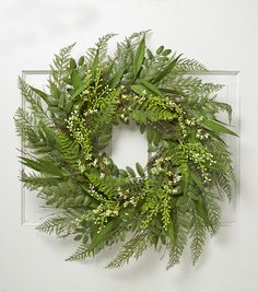 Welcome the spring with vibrant accessories like the Bloom Room 30 Meadow Spring Wreath. This leafy arrangement has a vibrant assortment of ferns. The ferns are designed in lifelike hues with delicate