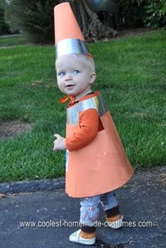 "Homemade Traffic Cone Toddler Halloween Costume: My year old son had decided to be a backhoe for Halloween, so I had to come up with a ""sidekick"" costume for my 11 month old. I wanted something relatively"