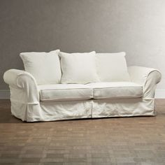 With easy, understated elegance, the Owen slipcovered sofa boasts clean lines and sharp tailoring. Details include classic rolled arms and a waterfall skirt combined with plump welted seat cushions and scatter-back pillows. Sectional Slipcover, Sofa Couch, Couch Set, Sleeper Sofa, Slipcovers, White Sofa Slipcover, Sofa Arm Covers, Diy Sofa Cover, Farmhouse Living Room Furniture