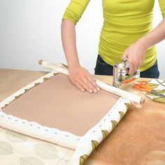 Re-covering an upholstered seat. Keep the fabric from bunching by wrapping the edge around a stick.