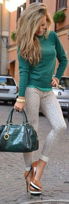 gray leopard skinny pants, green sweater with another lighter hue of green shirt, and nude heels