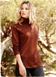 Pima Cotton Classic Turtleneck                        					                       				  			                			   			     				                  	                      	The iconic turtleneck, sewn of velvety soft Peruvian pima interlock with clean-edged cuffs and side slits.