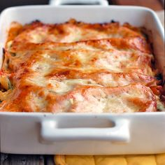 This skinny veggie lasagna has 200 calories per slice and is full of chopped broccoli, carrots, cauliflower, spinach, ricotta cheese, and tomato sauce.