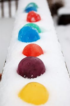 """Colored """"Glass"""" Fill small balloons with water & food coloring then pop the balloon once frozen. Then take them outside in the snow."""