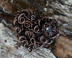 Copper and crystal. Love the double-wire curls.