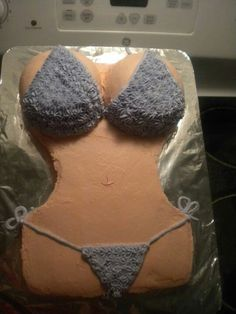 Boob bikini cake  *2 Cake Box Mixes *9×11 cake pan *Reserve 2 cups batter for boobs *2 Oven safe bowl to bake boobs *Shape cake for body  *Place boobs on body & shape *Frost, then draw bikini on body
