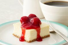 This is the absolute BEST cheesecake recipe I've ever tried. It's fantastic. If you have any leftovers I'd be surprised! It makes a very large pan so it's convenient to take to a bbq or a special occasion where you would be feeding a crowd. I use canned cherry topping on mine instead of the fresh strawberries but you could really use any kind of fruit.
