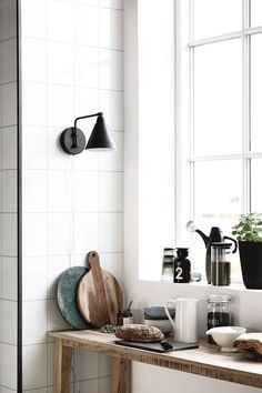 A mix of rustic wood, matte black metals, and sleek porcelain fill out to this light-filled nook.