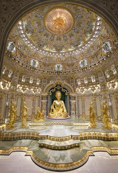BAPS Swaminarayan Akshardham (God's Abode) Temple  in New Delhi. Recognised by Guinness World Records as the Largest Temple in the World, built in only 5 years! The central figure is Lord Swaminarayan. The inner sanctum represents the beauty of Akshardham and the divine serenity in the garbhagruh inspires peace and divine happiness.