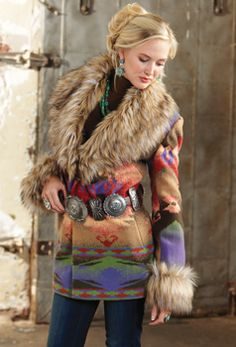 Fashion flashback. Recall the days of the great Comanche chief with dramatic, Indian blanket graphics and dashing, faux fur. Western flair.....pretty!