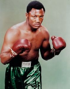 "Joe ""Smokin' Joe"" Frazier (1944 - 2011) Hall of Fame Professional Boxer. Olympic Gold Medalist. World Heavyweight Champion (1970 until 1973). Regarded by may as being one of the greatest fighters of his era, he is famed for his epic bouts against Muhammad Ali, notably the contest referred to as the ""Thrilla in Manila""."