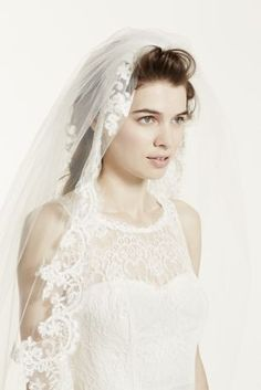 Intricate lace edge detailing will draw one's eye as you walk down the aisle in this captivating cathedral veil!