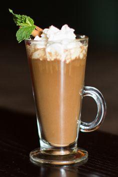 Mocha XO:  Ingredients:  3 oz milk  2 oz chocolate pieces  1/4 oz ground cinnamon  1 oz Patron XO  1/2 oz dulce de leche  1 shot (1 1/2 oz) hot espresso   Steps:  1. Steam milk with chocolate and cinnamon to create cinnamon chocolate milk.  2. In a mug, mix Patron, dulce de leche, and espresso shot. Stir in cinnamon chocolate milk.