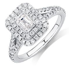 Love her now and forever with this splendid 1 1/2 carat total weight diamond Arpeggio ring, created in 14kt white gold. Featuring an emerald cut centerpiece surrounded by a double halo, the impressive look is further enhanced with diamonds set on the split shank shoulders. Finished with a pink sapphire set in 14kt rose gold, this is a ring that proves beauty is all in the details. Exclusive to the Michael Hill Designer Bridal Collection.