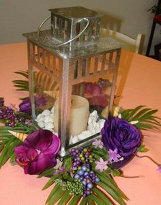 lantern ceterpices with purple | Centerpieces - Sand Petal Weddings