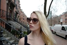 On a somewhat sunny day in downtown Boston, Alissa is wearing a frame that appears to be all wet. Downtown Boston, Classic Collection, Terrazzo, Sunny Days, Cat Eye, Sunnies, Round Sunglasses, Eyewear, Berlin