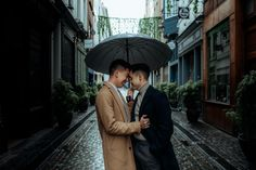 They posed beside murals, in a rainbow crosswalk and on stone streets. They also got some romantic photos in the rain. The post Urban engagement session on the streets of Brussels appeared first on Equally Wed, modern LGBTQ+ weddings + LGBTQ-inclusive wedding pros. Plan Your Wedding, Wedding Planning, Stone Street, Save The Date Photos, Romantic Photos, Niece And Nephew, Just Giving, Engagement Shoots, Getting Married