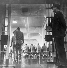 14 Apr 1962 - A guard stands by as prisoners enter the Alcatraz mess hall for supper. Before closing in 1963, Alcatraz was renowned for having the best food in the entire US prison system.