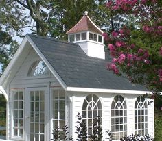 Adorable outdoor space could have many uses, such as a small pool house, gardening shed, child's doll house. The possibilities are endless. The cathedral windows and small steeple give it extra flair.