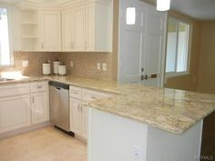 Perfect countertop! The cabinets are practically identical to the ones we have too. Keep it neutral so I can accent with kitchen items. Perfect way to keep it simple...since I have so much counter space now :)