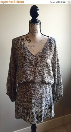 Gorgeous Short Dress or Long Shirt! Beautiful detailing in the Print! Size says XL but fits more like a Large. The waist is elasticized but please