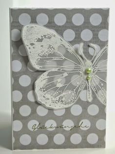 White Butterfly on vellum, white dots on grey