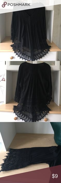 Black flowing button down blouse with lace Detailed and flowing V neck button down top. Longer in front than back; very flattering - dress up or down. Great condition. Tops Button Down Shirts