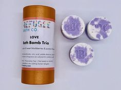 """Our handmade """"Love"""" bath bombs are made in Spokane Valley, Washington, by resettled refugees. The set includes three bath bombs with a blackberry and jasmine fragrance. They are packed in a recyclable tube ready for gift-giving. Bath Bomb Gift Sets, Sodium Bicarbonate, Cocoa Butter, Fragrance Oil, Bath Bombs, Stocking Stuffers, Blackberry, Spokane Valley, Jasmine"""