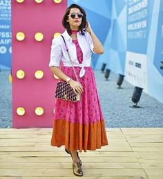 Colourful Maxi Dresses To Light Up Our Day.... #Akanksharedhu 's colourful and flowy maxi dress looks so retro and chic at the same time. We love the pink and orange combination and the minimal print. It is ingenious how she has paired the vibrant colours with a white top to balance the multi-colours.. Buy the look at https://www.estrolo.com/whatstrending/Colourful-maxi-dresses-to-light-up-our-day./