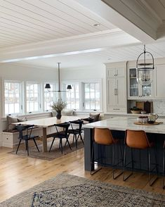 modern farmhouse design, modern farmhouse kitchen design with navy kitchen island and leather stools with open floor plan of modern farmhouse dining room decor with farmhouse table and black dining room chairs and built in banquette in dining area House Design, House, Interior, Home, House Inspiration, New Homes, House Interior, Home Interior Design, Interior Design