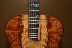 Stunning sapped redwood with African blackwood, bloodwood, and custom inlays by Batson Guitars.