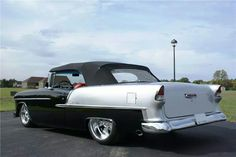 55 Chevy...... cant go wrong with the black silver and red color scheme
