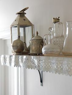 Decorate Your Kitchen Shelves With Lace Edging.