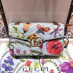 """Gucci Unskilled Worker GG Marmont Small Shoulder Bag 443497 cmPink satin liningOnline exclusiveLight blue """"Jeanie's Garden"""" print matelassé chevron leather with heart on the backAntique gold-toned hardwareDouble GIntern Gucci Handbags Sale, Handbags Online, Luxury Handbags, Gucci Bags, Gucci Shoulder Bag, Small Shoulder Bag, Gucci 2018, Designer Bags For Less, Gg Marmont"""