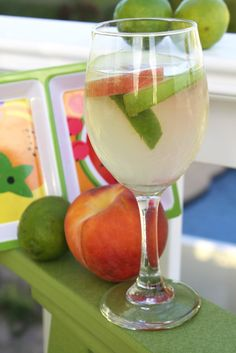 White Wine Sangria. 2 bottles of good white, 2 white peaches, 2 green apples, 2 limes, 4 Tbs sugar, 1 liter club soda.