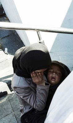 Syrian refugee woman with baby in Istanbul