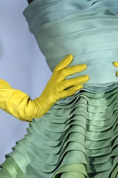 Christian Dior Haute Couture. The chrome-yellow gloves are a touch of genius considering the dress is blue and green; after all, blue + yellow = green.