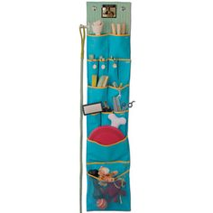 Eek!  What a great idea - hang dog stuff vertically in an organizer instead of in a closet, basket or tote.... Solstice Wall Hanging Organizer  by Yep Yup