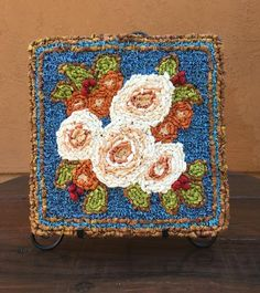 The first in a collection of garden themed panels for locker hooking, the Winter Bouquet is a plush design with Peony blossoms in raised relief. There's lots of