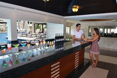Get your drinks by the pool bar.